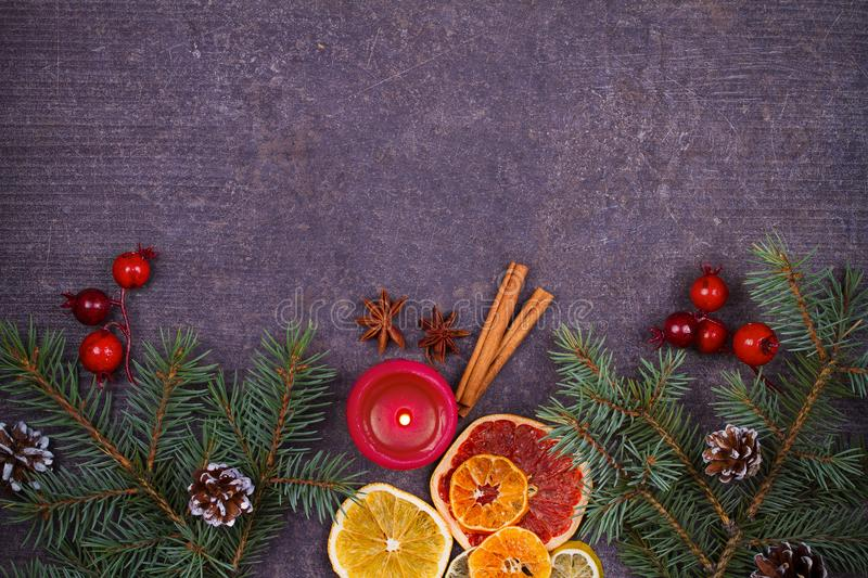 Christmas and New Year border or frame on grunge wooden background. Winter holidays concept. View from above, top studio shot. Horizontal royalty free stock photo