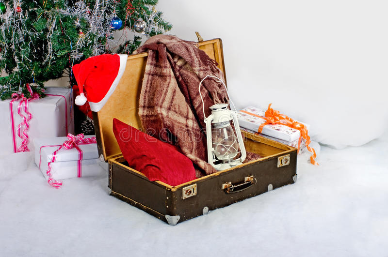 Christmas new year card suitcase Santa Claus with gifts stock image