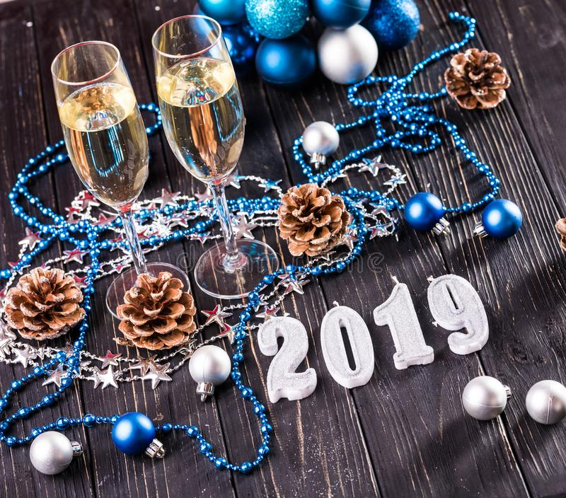 Christmas and New Year celebration with champagne. New Year holiday decorated table. Two Champagne Glasses stock photo