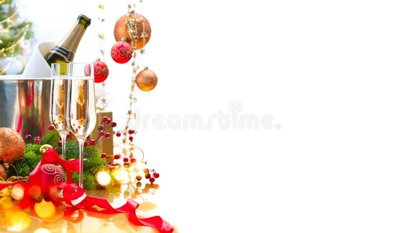 Christmas and New Year celebration with champagne. Holiday dinner table setting with Christmas tree decoration royalty free stock image