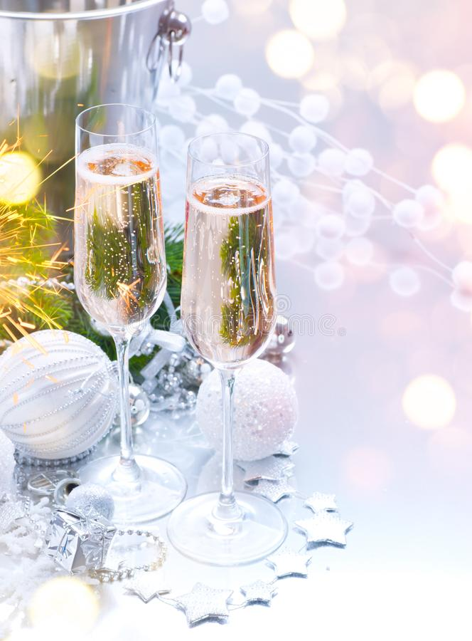 Christmas and New Year celebration with champagne. Holiday dinner table setting with Christmas tree decoration royalty free stock images