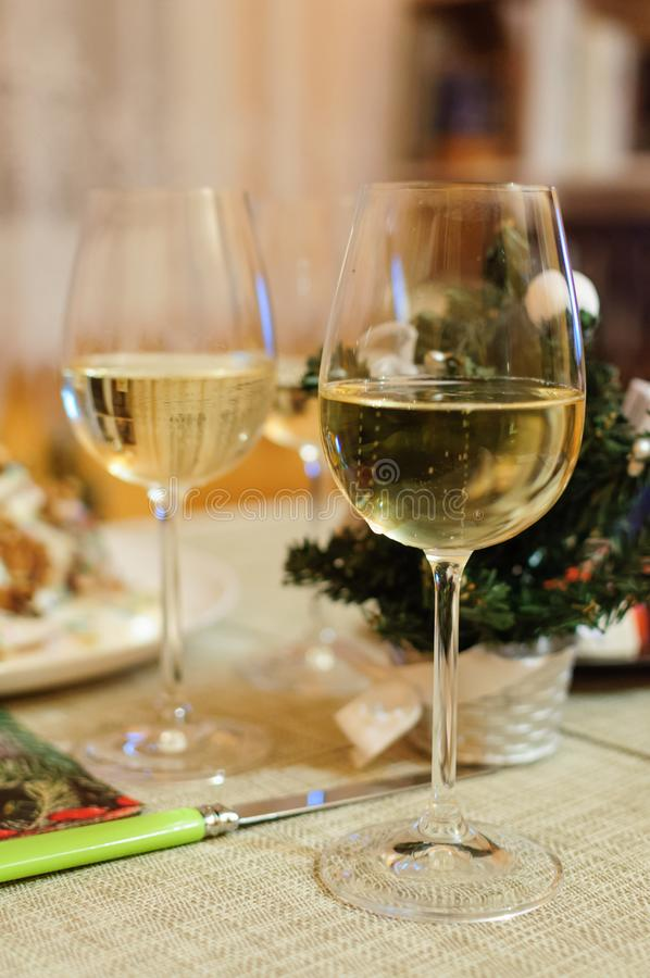 Christmas and New Year celebration with champagne. New Year holiday decorated table. Two Champagne Glasses royalty free stock photo
