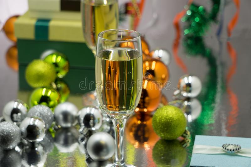 Christmas and New Year celebration with champagne. New Year holiday decorated table. Two Champagne Glasses, vintage toned royalty free stock images