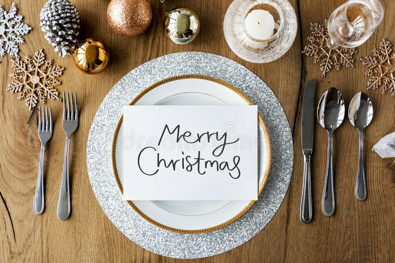 Merry Christmas card and festive table settings royalty free stock photo