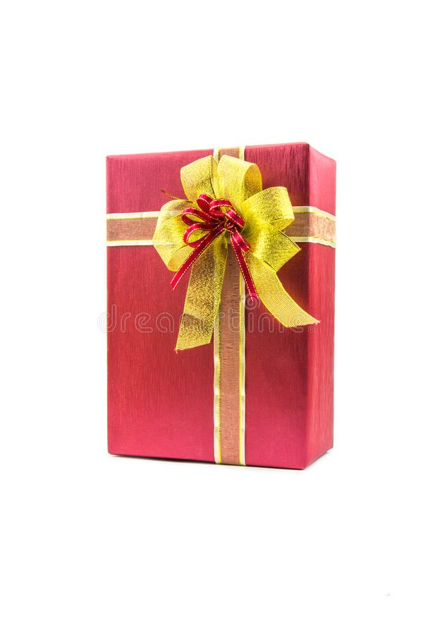 Christmas new year celebration decorations concept - Red and ribbon gold gifts box and decorating elements on white background royalty free stock images