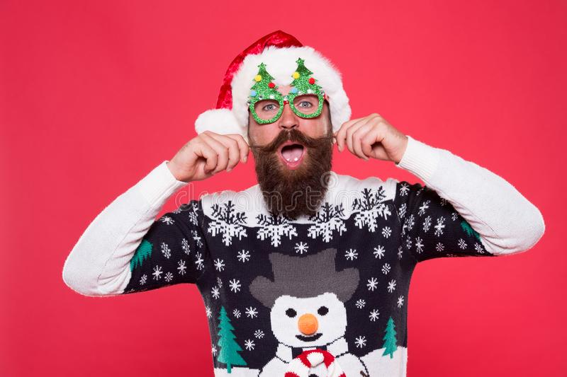 Christmas and New Year celebration. Happy bearded man with santa look. Well groomed mustache. Barbershop concept. Santa royalty free stock images