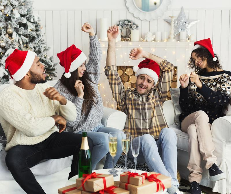 Happy friends celebrating New Year with champagne royalty free stock photo