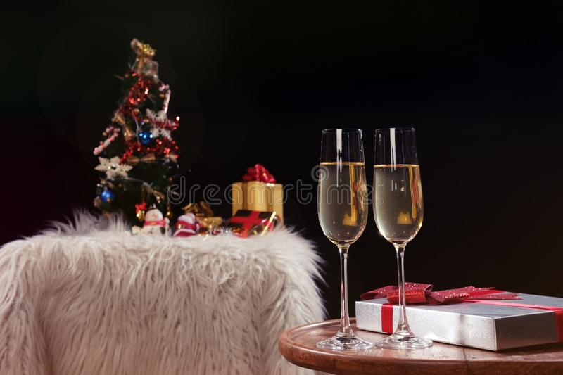Christmas or New Year Celebration people hands with crystal glasses full of champagne near the Christmas tree and space for your royalty free stock images