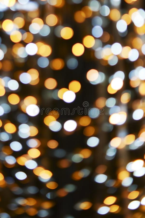 Christmas and new year bokeh lights background. Christmas, new year, club and party bokeh white and gold sparkle lights background stock images