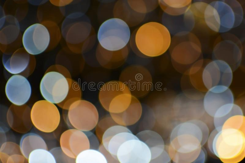 Christmas and new year bokeh lights background. Christmas, new year, club and party bokeh white and gold sparkle lights background stock photography