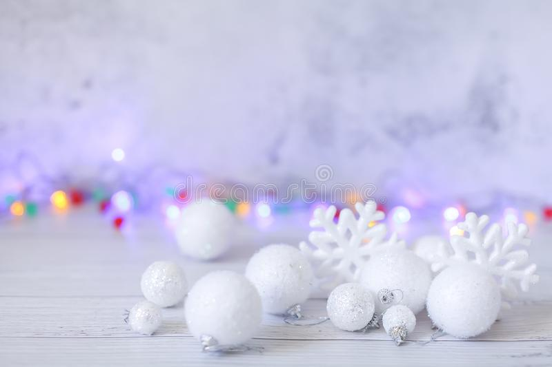 New year or Christmas decorations in silver and white colors with balls, snowflakes and garland bokeh stock photos