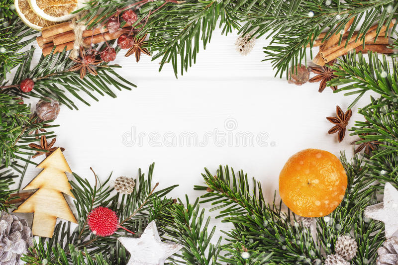 Christmas New Year composition with cinnamon sticks on. Top view Christmas New Year composition with cinnamon sticks on wooden background, frame copy space stock photography
