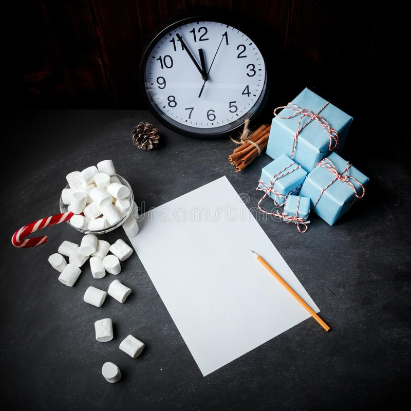Christmas New Year composition cinnamon vintage gifts paper mars. Hmallows clock candy stick Top View place for text design banner royalty free stock photos