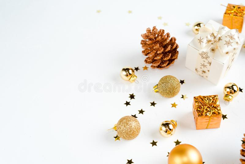 christmas or new year composition. christmas decorations in gold colors on white background with empty copy space for text. holida royalty free stock photos