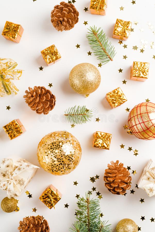 christmas or new year composition. christmas decorations in gold colors on white background, holiday and celebration concept for stock images