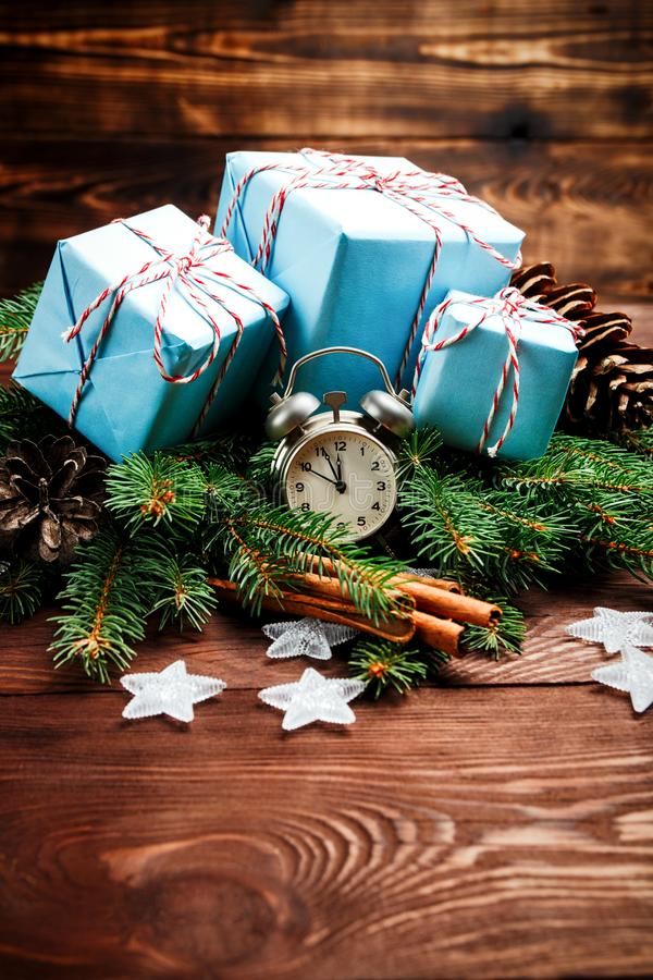 Christmas New Year composition fir branches pine cone cinnamon vintage gifts thread paper stars alarm clock wooden table Top View. Place for text vintage style royalty free stock photos