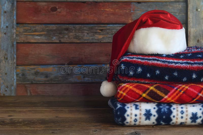Christmas and New Year composition. Plaid, Santa Claus hat on wooden background. Winter Holiday concept royalty free stock images