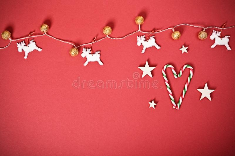 Seasonal greeting card concept with Christmas lights and candy cane heart. Christmas and New Year composition. Seasonal greeting card concept with white royalty free stock images