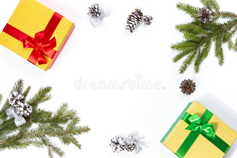 Christmas and New Year Concept. Gift Boxes, Cones, Fir Tree Branches Placed together On White Background. Top View royalty free stock photography