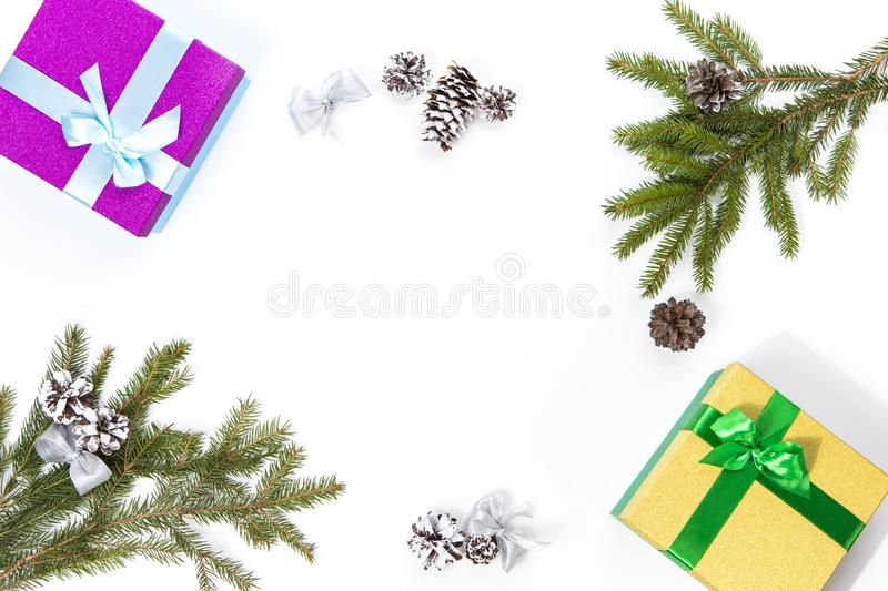 Christmas and New Year Concept. Gift Boxes, Cones, Fir Tree Branches Placed together On White Background. Top View stock image