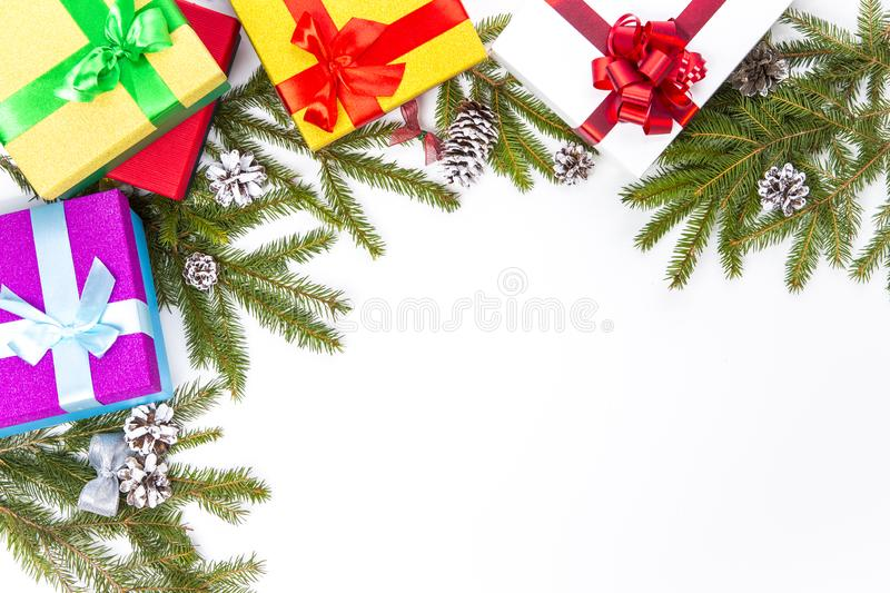 Christmas and New Year Concept. Gift Boxes, Cones, Fir Tree Branches Placed together On White Background. Top View royalty free stock images