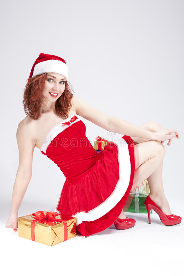 Christmas and New Year Concept and Ideas. Positive Caucasian Santa Helper Girl Posing with Gifts stock photography
