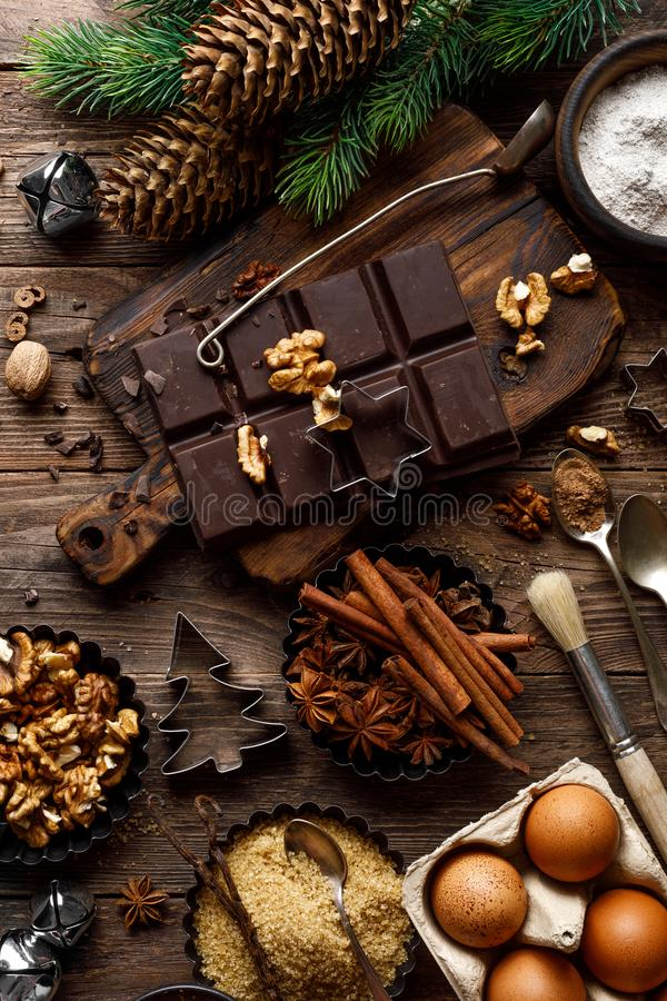 Christmas or new year culinary rustic wooden background with food ingredients for cooking festive dishes, xmas baking. Holiday coo stock photo