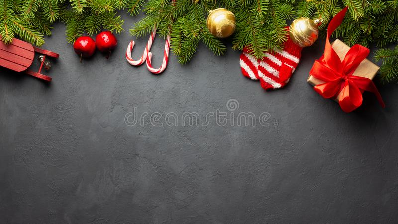 Christmas or New Year dark background. Fir tree and xmas decor. Top view with copy space stock photo