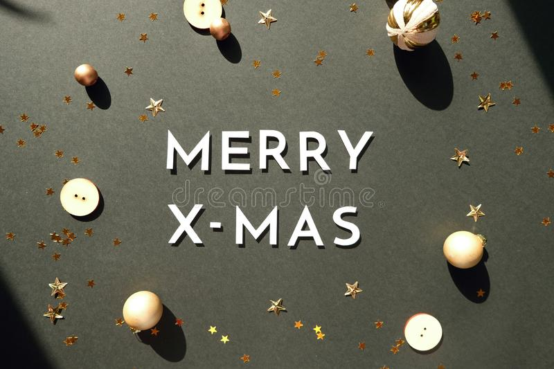 Christmas or New Year decoration background: colorful glass balls on black background with copy space. Merry christmas and happy new year wiyh gold decoration on stock photo