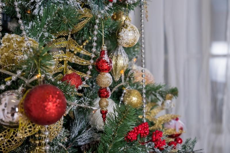 Christmas and New Year Decoration. Winter holidays art design with holiday baubles. Beautiful Christmas tree closeup stock photos