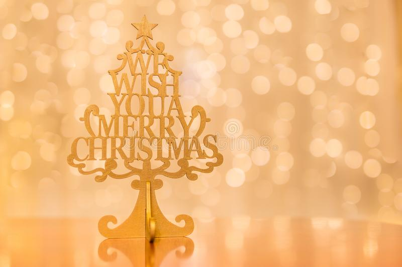 Christmas tree on golden blurred background, Xmas concept stock image