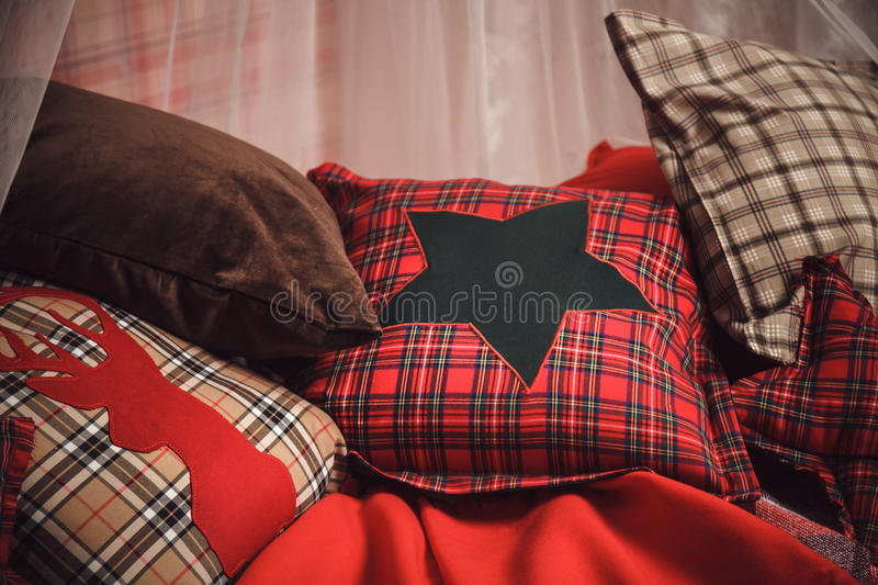 Christmas and new year decoration on tartan background. Christmas and new year decoration with tartan background - plaids and pillows stock image