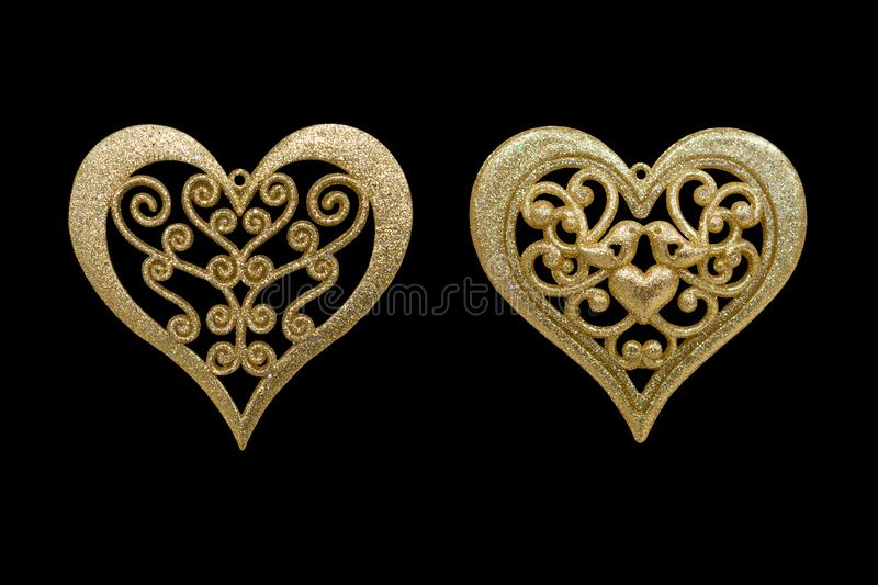 Christmas and New Year decorations: figurines of golden heart. I. Solated, black background stock photography