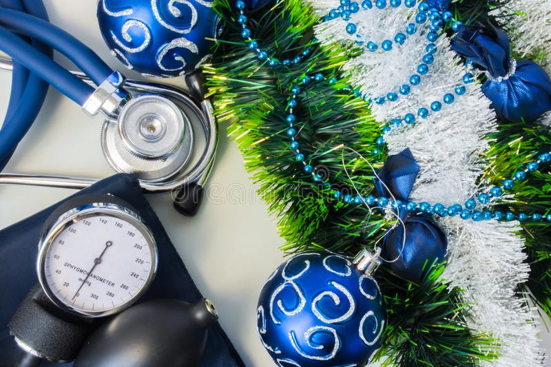 Christmas New Year decorations and medical diagnostic devices. Stethoscope with a device for measuring pressure or sphygmomanomete stock photo