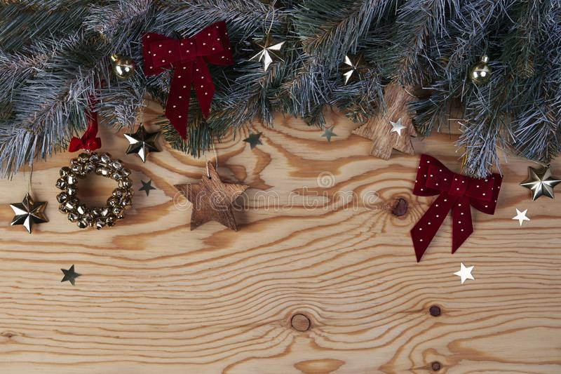 Christmas New Year eve background with fir tree and decoration on light wooden board stock images