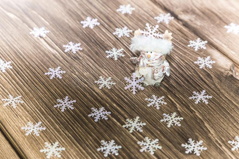 Christmas and New Year festive background. A smiling snowman and stock photos