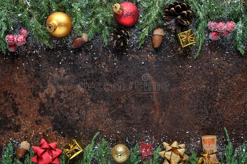 Christmas or New Year flat lay composition. Christmas tree branches, pine cones, Christmas balls, gift box, and other royalty free stock photo