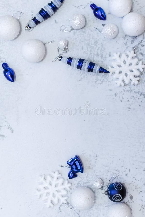 Christmas or new year flat lay composition in silver white and blue colors with balls snowflake and toys stock photos