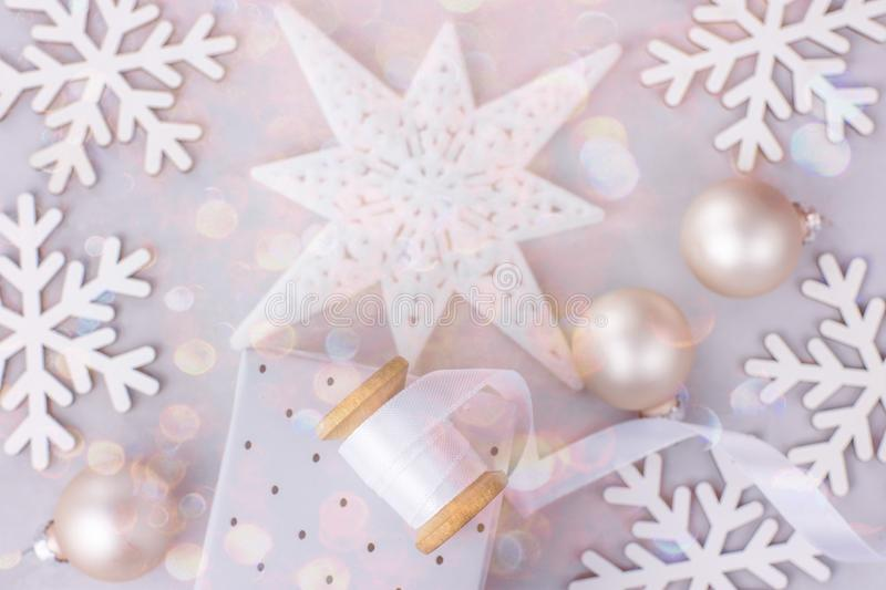 Christmas New Year Frame Banner Background Snow Flakes Star Baubles Gift Box White Silk Ribbon Spool Colorful Confetti Glitter royalty free stock photo