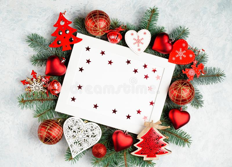 christmas or new year frame composition. christmas decorations in red colors on white background with empty copy space for text. royalty free stock image