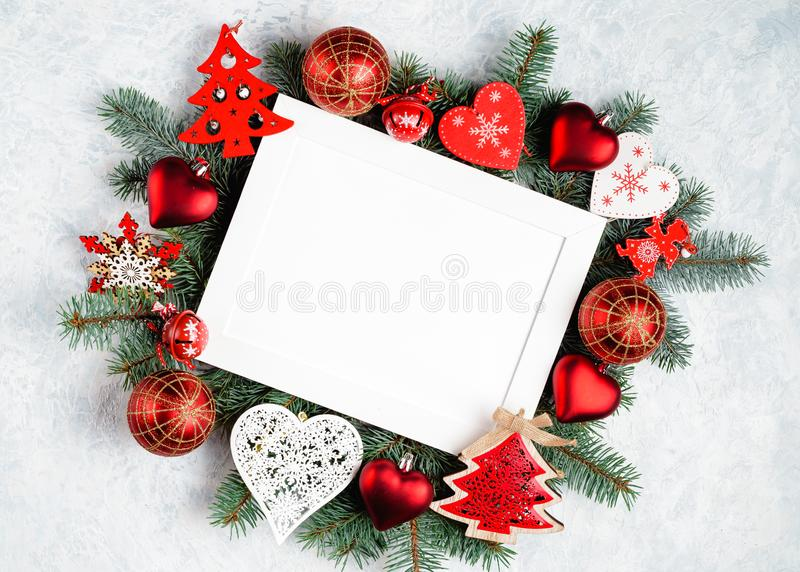 christmas or new year frame composition. christmas decorations in red colors on white background with empty copy space for text. royalty free stock photography