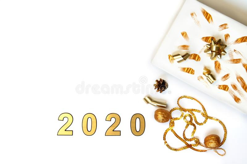2020 Christmas and new year frame made of white and golden christmas decorations on isolation on white background. royalty free stock images