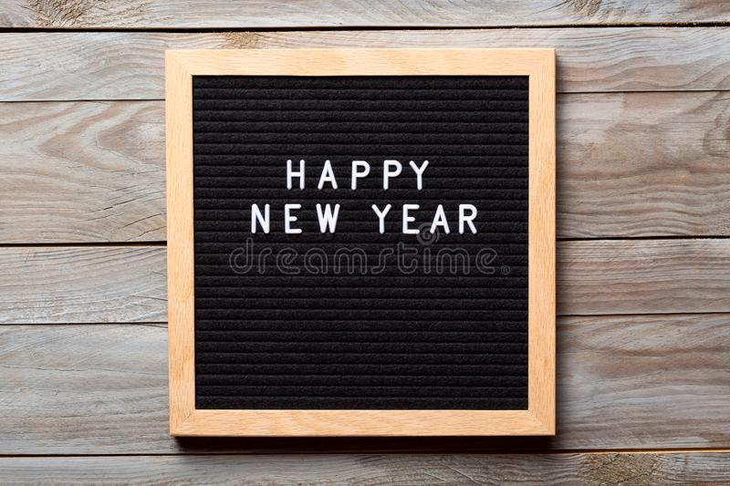 Christmas or new year frame or mockup for your project. Happy new year words on a letter board on wooden background stock image