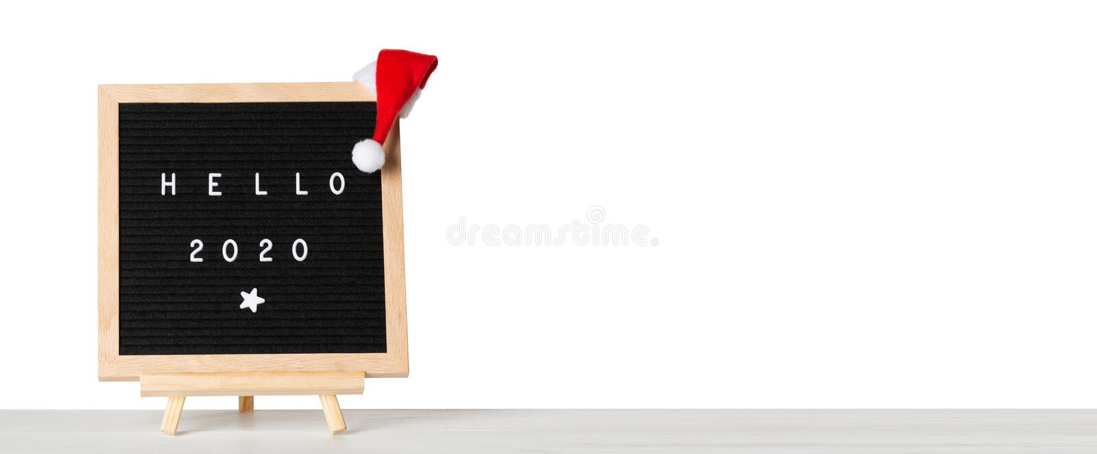 Christmas or new year frame or mockup for your project. Hello 2020 words on a letter board with santa hat against white isolated. Background royalty free stock photography