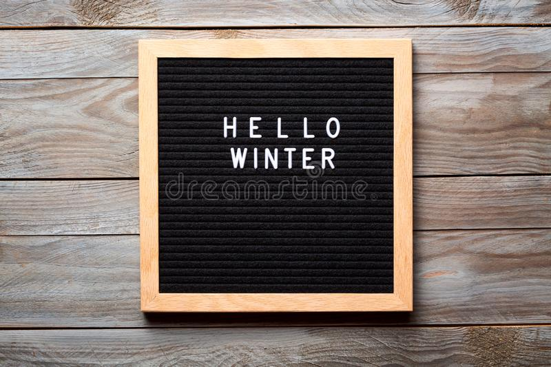 Christmas or new year frame or mockup for your project. Seasonal frame. Hello Winter words on a letter board on wooden background stock images