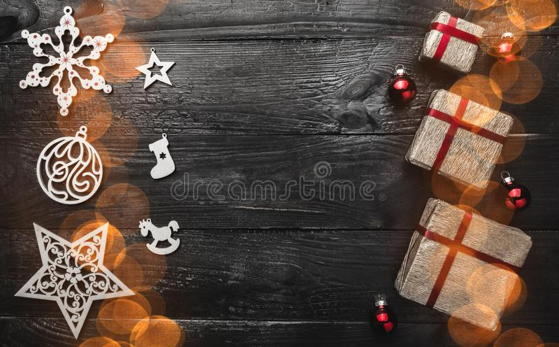 Christmas or new year gifts presents on black background. Simple, classic, golden wrapped gift boxes with red ribbon royalty free stock images
