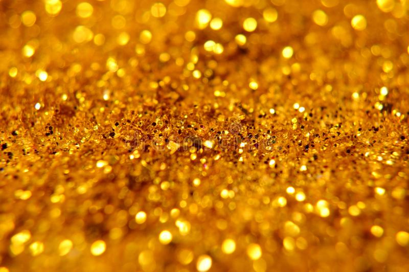 Golden glitter texture Colorfull Blurred abstract background for birthday, anniversary, wedding, new year eve or Christmas. Annive. Rsary, blurred. Christmas new royalty free stock photos