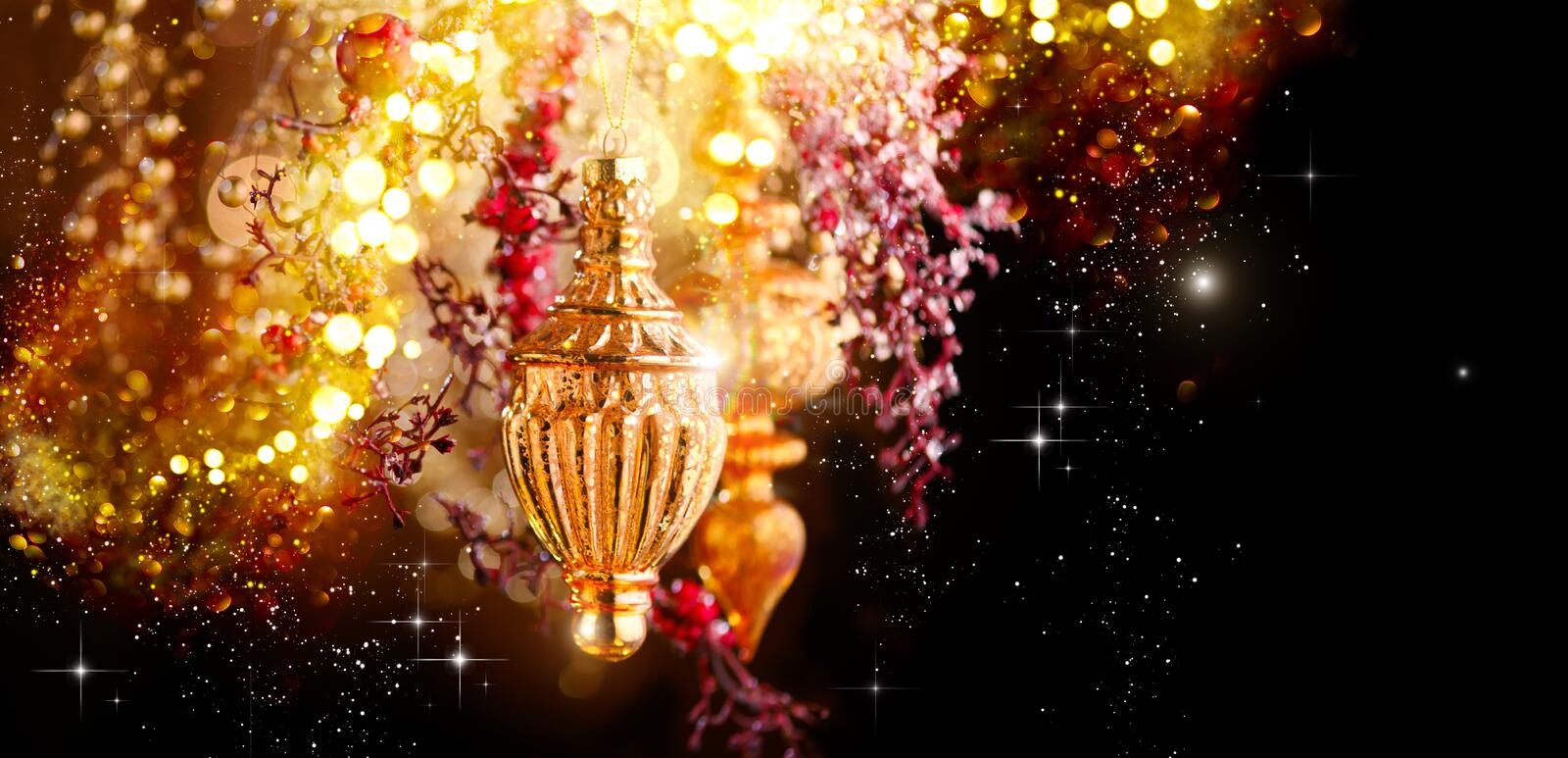 Christmas and New Year Golden Decoration. Abstract Blurred Bokeh Holiday Background with beautiful baubles and Blinking Garland. Christmas Tree Lights royalty free stock image