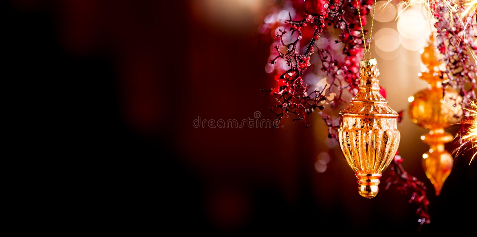 Christmas and New Year Golden Decoration. Abstract Blurred Bokeh Holiday Background with beautiful baubles and Blinking Garland. Christmas Tree Lights stock photography