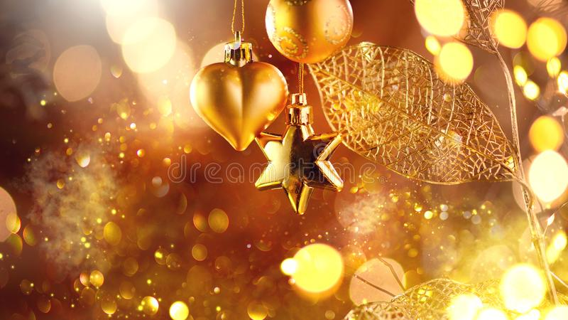 Christmas and New Year golden Decoration. Abstract Blurred Bokeh Holiday Background with beautiful baubles and Blinking Garland. Christmas Tree Lights stock image